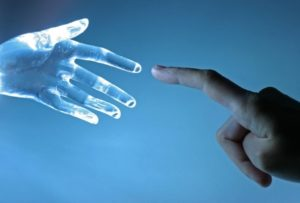 Human hand reaching finger to finger of a non-human hand suggesting AI connection