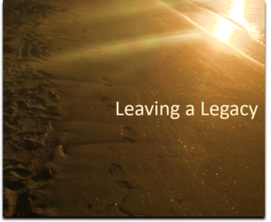 """Ocean beach with footsteps and words """"Leaving a legacy"""""""
