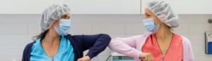 two nurses knocking elbows