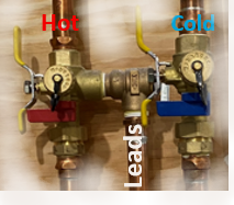 Hot and cold copper pipes connected by feed line