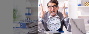 A person chained to a clock very frustrated and over-worked with sample issues stated to left