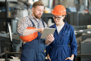 Man and woman using tablet at worksite