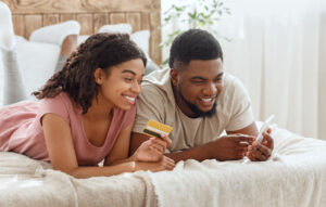 Couple making mobile purchase from home